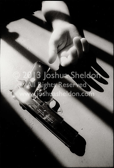 Limp Hand and .45 Caliber Gun