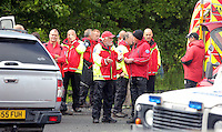 Pictured: Mountain Rescue staff at Tafarn Y Garreg, Powys, Wales UK. Wednesday 29 June 2016<br />Re: Rescuers have found a number of the 24 children who went missing the Brecon Beacons.<br />Dyfed-Powys Police said a Coastguard helicopter had found some the children, who are from St Albans, Hertfordshire.<br />The helicopter has landed and the crew are with the children, but their condition is not known.<br />The alarm was raised at about 13:00 BST after the groups went missing around Llyn y Fan Fach, near Abercraf.<br />The children are in their mid teens and were on the beacons as part of their Duke of Edinburgh Award.<br />Mark Moran from Central Beacons Mountain Rescue said his team had been in intermittent phone contact with the four groups of six children before the first group were found.