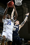 SIOUX FALLS, SD - MARCH 8: Douglas Wilson #35 of the South Dakota State Jackrabbits battles for the ball with Carlos Jurgens #11 of the Oral Roberts Golden Eagles during the Summit League Basketball Tournament at the Sanford Pentagon in Sioux Falls, SD. (Photo by Dave Eggen/Inertia)