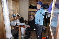 Thursday March, 2012    Ophir communications specialists Jim Pekarek and Katie Kerris inside their small wall-tent haven. .   Iditarod 2012.