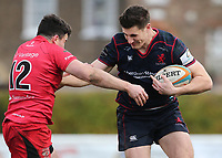 Ross Neal of London Scottish is tackled during the Greene King IPA Championship match between London Scottish Football Club and Jersey at Richmond Athletic Ground, Richmond, United Kingdom on 16 December 2017. Photo by Mark Kerton / PRiME Media Images.