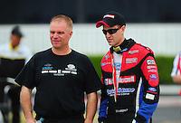 Nov. 10, 2011; Pomona, CA, USA; NHRA funny car driver Tim Wilkerson (left) talks with Bob Tasca III during qualifying at the Auto Club Finals at Auto Club Raceway at Pomona. Mandatory Credit: Mark J. Rebilas-.
