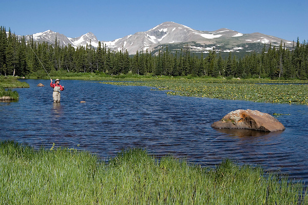 """Angler fly fishing at Brainard Lake, Boulder, Colorado. From: """"Boulder, Colorado: A Photographic Portrait."""" Private photo tours to Indian Peaks. .  John leads private photo tours in Boulder and throughout Colorado. Year-round."""