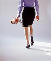 Woman walking away with Raggedy Ann doll