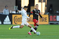 WASHINGTON, DC - MARCH 07: Victor Ulloa #13 of Inter Miami CF battles the ball with Erick Sorga #50 of D.C. United during a game between Inter Miami CF and D.C. United at Audi Field on March 07, 2020 in Washington, DC.