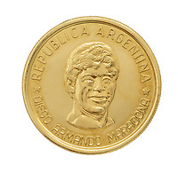 BNPS.co.uk (01202 558833)<br /> Pic: Julien'sAuctions/BNPS<br /> <br /> Pictured: Alfredo Di Stefano Diego Maradona Coin.<br /> <br /> An epic collection of medals, trophies, shirts and personal items relating to footballing legend Alfredo Di Stefano is being sold by his family for over £1m.<br /> <br /> Many of the awards won by the great goalscorer have, until recently, been on display at the Real Madrid Museum, the club where he played for most of his career.<br /> <br /> The Argentine-born striker is regarded as one of the best players of all-time and is often compared to Cristiano Ronaldo.<br /> <br /> During Di Stafano's time with Real Madrid in the 1950s and '60s, the Spanish giants dominated European football, largely due to his goals and assists.