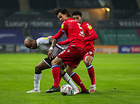 30th December 2020; Liberty Stadium, Swansea, Glamorgan, Wales; English Football League Championship Football, Swansea City versus Reading; Andre Ayew of Swansea City and Tom McIntyre of Reading FC jostle for possession
