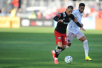 WASHINGTON, DC - MARCH 07: Erick Sorga #50 of D.C. United battles the ball with Nicolas Figal #5 of Inter Miami CF during a game between Inter Miami CF and D.C. United at Audi Field on March 07, 2020 in Washington, DC.
