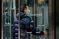 NEW YORK, NEW YORK - MARCH 17: A man enter to JP Morgan offices on March 17, 2021 in New York. JPMorgan Chase & Co is planning to have its  interns working from offices in London and New York City,  around June when the program begins but cautioned that the idea will depend on government guidance. (Photo by John Smith/VIEWpress)