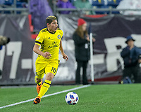 Foxborough, Massachusetts - May 19, 2018:  In a Major League Soccer (MLS) match, Columbus Crew (yellow) defeated New England Revolution (white/red), 1-0, at Gillette Stadium.