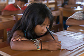 Xingu Indigenous Park, Mato Grosso State, Brazil. Aldeia Tuba Tuba (Yudja). Girl writing at her desk in the school.
