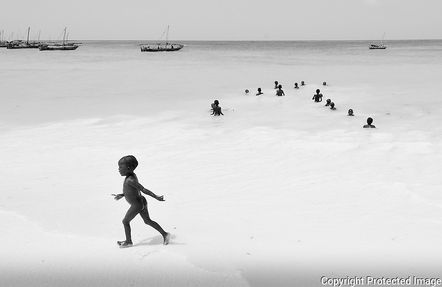 Children playing and have fun on the beach