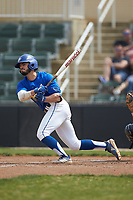 Daniel Vitello (5) of the Mars Hill Lions follows through on his swing against the Queens Royals at Intimidators Stadium on March 30, 2019 in Kannapolis, North Carolina. The Royals defeated the Bulldogs 11-6 in game one of a double-header. (Brian Westerholt/Four Seam Images)
