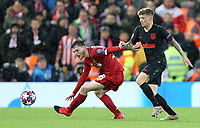 Liverpool's Andrew Robertson shields the ball from Atletico Madrid's Kieran Trippier<br /> <br /> Photographer Rich Linley/CameraSport<br /> <br /> UEFA Champions League Round of 16 Second Leg - Liverpool v Atletico Madrid - Wednesday 11th March 2020 - Anfield - Liverpool<br />  <br /> World Copyright © 2020 CameraSport. All rights reserved. 43 Linden Ave. Countesthorpe. Leicester. England. LE8 5PG - Tel: +44 (0) 116 277 4147 - admin@camerasport.com - www.camerasport.com
