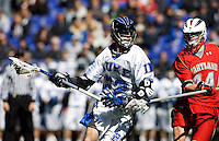 Ned Crotty (22) of Duke moves in on Brett Schmidt (44) of Maryland during the Face-Off Classic in at M&T Stadium in Baltimore, MD