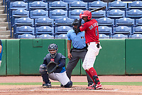 Clearwater Threshers Carlos De La Cruz (6) bats in front of catcher Carlos Narvaez (5) and umpire Rainiero Valero during a game against the Tampa Tarpons on June 13, 2021 at BayCare Ballpark in Clearwater, Florida.  (Mike Janes/Four Seam Images)