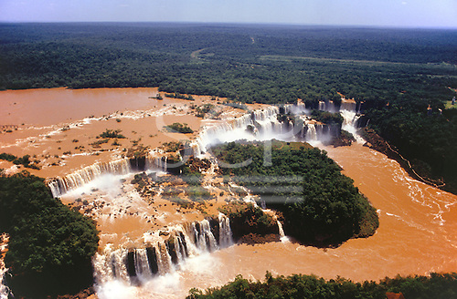 Iguassu Falls, Parana State, Brazil. Aerial view of the waterfalls, rainforest in the background.