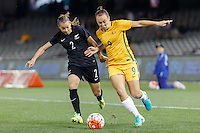 June 7, 2016: RIA PERCIVAL (2) of New Zealand and CAITLIN FOORD (9) of Australia compete for the ball during an international friendly match between the Australian Matildas and the New Zealand Football Ferns as part of the teams' preparation for the Rio Olympic Games at Etihad Stadium, Melbourne. Photo Sydney Low
