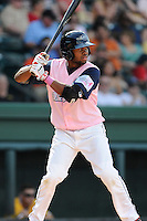Center fielder Manuel Margot (2) of the Greenville Drive bats in a game against the West Virginia Power on Sunday, May 11, 2014, at Fluor Field at the West End in Greenville, South Carolina. Margot is the No. 13 prospect of the Boston Red Sox, according to Baseball America. Greenville won, 9-6. (Tom Priddy/Four Seam Images)