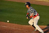 Erick Salcedo #14 of the Burlington Bees bunts against the Clinton LumberKings at Community Field  on July 3, 2014 in Burlington, Iowa. The LumberKings beat the Bees 6-5.   (Dennis Hubbard/Four Seam Images)