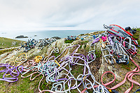 Nick Bullock's climbing rack spread on top of the cliff at Rhoscolyn, Gogarth, North Wales