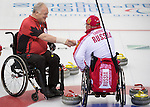Sochi, RUSSIA - Mar 8 2014 -  Jim Armstrong shakes hands after his team defeated Russia in round robin play in Wheelchair Curling during the 2014 Paralympic Winter Games in Sochi, Russia.  (Photo: Matthew Murnaghan/Canadian Paralympic Committee)