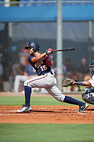 GCL Twins second baseman Estamy Urena (15) follows through on a swing during a game against the GCL Rays on August 9, 2018 at Charlotte Sports Park in Port Charlotte, Florida.  GCL Twins defeated GCL Rays 5-2.  (Mike Janes/Four Seam Images)