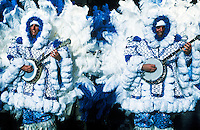 A man in the Fancy Division is dressed in a blue costume of feathers marching with bango in the Mummers Day Parade on New Years Day, Philadelphia, Pennsylvania