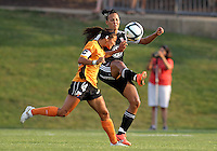 BOYDS, MARYLAND-JULY 07,2012:  Lianne Sanderson (10) of DC United Women has the ball headed away by Jen Agueci (14) of Dayton Dutch Lions during a W League game at Maryland Soccerplex, in Boyds, Maryland. DC United women won 4-1.