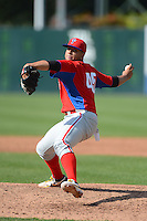 Pitcher Keven Pimentel (45) of Montverde Academy participates in the East Coast Pro Showcase with the Philadelphia Phillies scout team on July 31, 2013 at NBT Bank Stadium in Syracuse, New York.  Pimentel was injured in the game and did not return.  (Mike Janes/Four Seam Images)