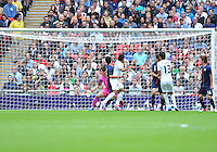 August 07, 2012..Japan's Shuichi Gonda watches the ball go in the nets as Mexico's Marco Fabian scores during Semi Final match at the Wembley Stadium on day eleven in Wembley, England. Mexico defeat Japan 3-1 to reach Men's Finals of the 2012 London Olympics...