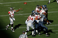 Sep 18, 2005; Seattle, WA, USA; Atlanta Falcons quarterback Michael Vick #7 throws a pass against the Seattle Seahawks in the third quarter at Qwest Field. Mandatory Credit: Photo By Mark J. Rebilas
