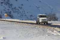 Pictured: A snow covered car travels on the A470 at Storey Arms in the Brecon Beacons, Wales, UK. Monday 11 December 2017<br /> Re: Freezing temperatures, snow and ice has affected parts of the UK.