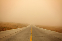 A road disappears into the distance during a sandstorm near the city of Zhongwei, in Ningxia Province. Increasing desertification in the region has resulted in more sandstorms which continue to plague this region, especially in the spring months.