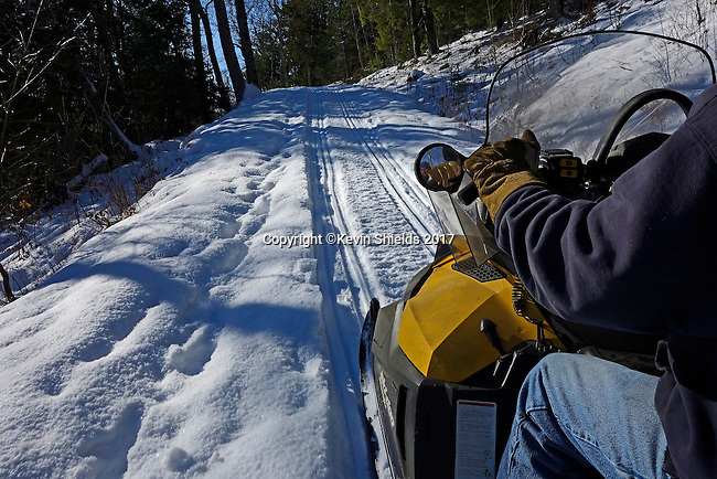 Snowmobiling in Camden Hills State Park, Maine, USA