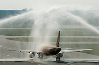 The inaugural flight of Skybus Airlines travels under spray from fire trucks to celebrate its inaugural flight Tuesday, May 22, 2005.  Skybus Airlines Inc., will compete with Southwest Airlines Co., JetBlue Airways Corp. and other low-cost companies.