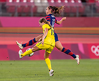 KASHIMA, JAPAN - AUGUST 5: Courtney Nevin #19 of Australia is defended by Alex Morgan #13 of the USWNT during a game between Australia and USWNT at Kashima Soccer Stadium on August 5, 2021 in Kashima, Japan.