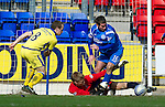 St Johnstone v Kilmarnock....02.04.11 .Peter MacDonald is brought down by keeper Annsi Jaakkola but no penalty was awarded.Picture by Graeme Hart..Copyright Perthshire Picture Agency.Tel: 01738 623350  Mobile: 07990 594431