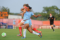 Cat Whitehill (4) of the Washington Freedom and Rosana (11) of Sky Blue FC battle for the ball. Sky Blue FC and the Washington Freedom played to a 0-0 tie during a Women's Professional Soccer (WPS) match at Yurcak Field in Piscataway, NJ, on July 7, 2010.