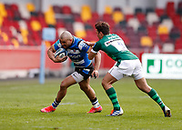 27th March 2021; Brentford Community Stadium, London, England; Gallagher Premiership Rugby, London Irish versus Bath; Johnathan Joseph of Bath is tackled by Nick Phipps of London Irish