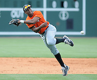 Shortstop Sharlon Schoop (2) of the Augusta GreenJackets runs down a grounder during an infield drill prior to a game against the Greenville Drive on May 20, 2010, at Fluor Field at the West End in Greenville, S.C. Photo by: Tom Priddy/Four Seam Images