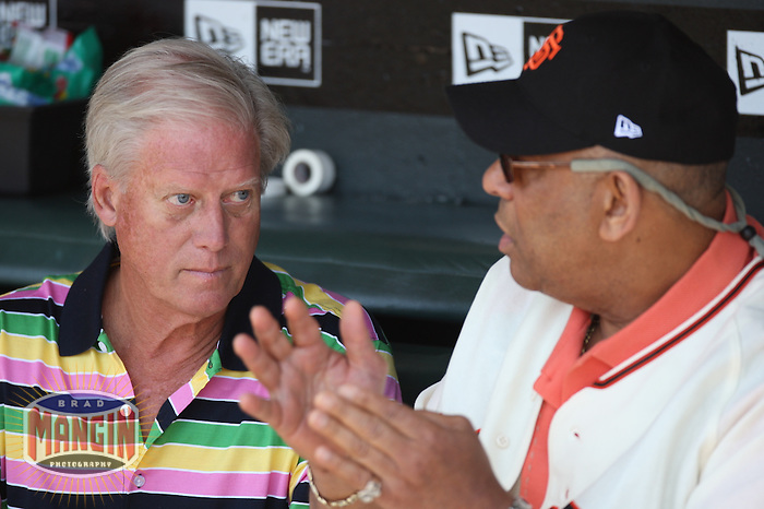 SAN FRANCISCO - June 24:  Owner Peter Magowan of the San Francisco Giants talks in the dugout with former Giant Orlando Cepeda before the game against the New York Yankees at AT&T Park in San Francisco, California on June 24, 2007. Photo by Brad Mangin