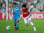 Ryo Miyaichi of Arsenal FC and Lam Ka Wai of Kitchee in action during the pre-season Asian Tour friendly match at the Hong Kong Stadium on July 29, 2012. Photo by Victor Fraile / The Power of Sport Images