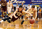 BROOKINGS, SD - FEBRUARY 27:  Brett Olson #23 from Denver University dives for the loose ball with  Brayden Carlson #12 from South Dakota State in the first half of their game Thursday night at Frost Arena in Brookings. (Photo by Dave Eggen/Inertia)