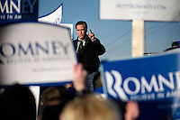 """Republican presidential candidate Mitt Romney, former governor of Massachusetts, speaks to supporters and the media at a rally in Manchester, New Hampshire, on Sat. Dec. 3, 2011. The rally was called, """"Earn It with Mitt,"""" and was designed to bolster local efforts to help Romney """"earn"""" voters' support for the upcoming Republican primary."""