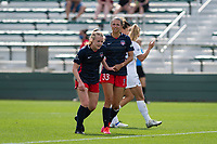 CARY, NC - APRIL 10: Anna Heilferty #21 of the Washington Spirit gets encouragement from Ashley Hatch #33 of the Washington Spirit during a game between Washington Spirit and North Carolina Courage at Sahlen's Stadium at WakeMed Soccer Park on April 10, 2021 in Cary, North Carolina.
