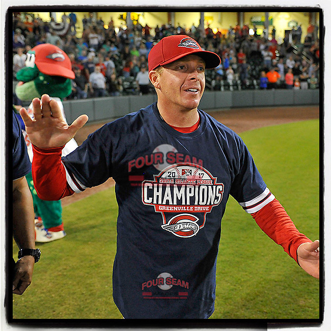 Manager Darren Fenster of the Greenville Drive celebrates the 2017 South Atlantic League Championship following an 8-3 win over the Kannapolis Intimidators in Game 4 of the Championship Series on Friday, September 15, 2017, at Fluor Field at the West End in Greenville, South Carolina. It was Greenville's first SAL Championship. Greenville won the series 3-1. (Tom Priddy/Four Seam Images)