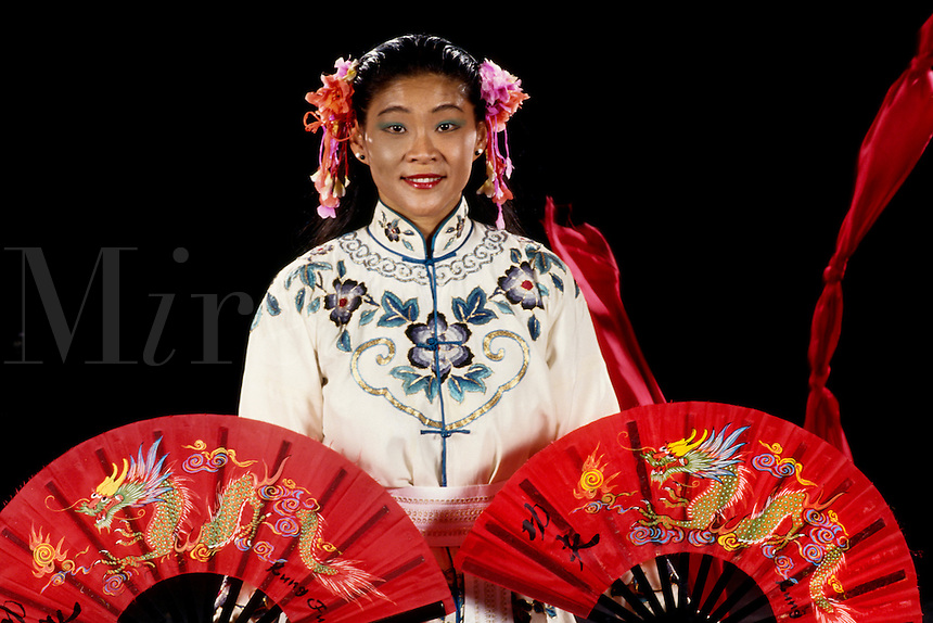 Chinese dancer in Hong Kong doing Red Flag Dance with color and fans