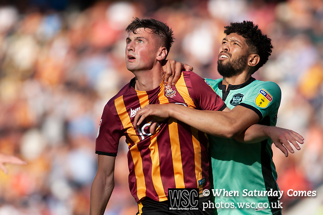 Bradford City 3, Carlisle United 1, 21/09/2019. Valley Parade, EFL League 2. The home team defender Paudie O'Connor is challenged by ex-home team defender Nathaniel Knight-Percival during the first-half as Bradford City played Carlisle United in a Skybet League 2 fixture at Valley Parade. The home team were looking to bounce back after being relegated during a disastrous 2018-19 season on and off the pitch. Bradford won the match 3-1, watched by a crowd of 14, 217. Photo by Colin McPherson.
