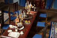 BNPS.co.uk (01202) 558833<br /> Pic: ZacharyCulpin/BNPS<br /> <br /> The dining room<br /> <br /> A model maker who spent 25 years building a stunning miniature Georgian mansion has put it up for sale for £8,750.<br /> <br /> Len Martin spared no expense or time in creating the incredibly ornate model home that includes Swarovski chandeliers, gold furniture and artwork from Egyptian King Farouk's artist.<br /> <br /> The 42ins tall property also boasts a sweeping driveway, 16 statues, 138 balustrades, marble floors, stone cherubs on the ceilings and more tiny oil paintings crafted by real artists.
